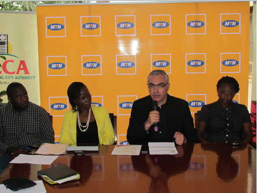 MTN CEO Mazen Mroué (Centre right) addresses guest at the event alongside MTN Senior Internal Audit Manager Judith Namugenyi (Right) and KCCA officials.