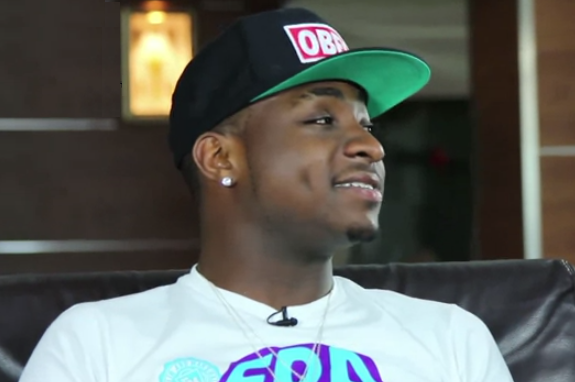 video davido poses with a live snake