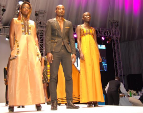 Models showcase the latest creations by fashion icon Stella Atal during the launch of the Barclays Bank credit card in Uganda.