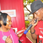 A Coke ambassador interacts with a lady after giving her her own personalised Coke can on Valentine's day.