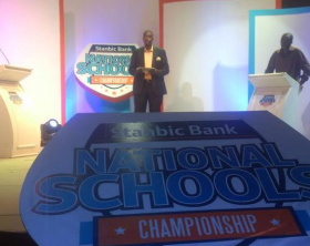 DJ Bushbaby Versus DJ Beekay with the Stanbic Bank National Schools Championship host Marcus Kwikiriza of Capital FM breakfast show competing for a prize during the launch of the Stanbic Bank Schools Championship at UTL Warehouse on 5th Street Industrial Area today.