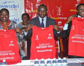 Airtel Uganda Brand & communication head, Remmie Kisakye, Owek. Sekabembe Henry and Owek. Charles Peter Mayiga display the kits that were handed over by Airtel Uganda.
