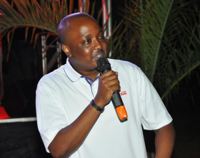 Coca-Cola Uganda Brand Manager; Rodney Nzioka addresses guests during the launch their new global campaign ''Taste the Feeling'' at Nile Village Hotel in Jinja.