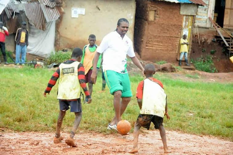 Enjoys soccer with ugandan ghetto kids on a muddy ground bigeye ug