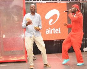 Airtel Ambassador Uganda, Eddy Kenzo perfroming for Matia Tamale, the Airtel Money Yoola Amajja winner at the grand finale.