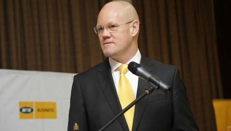 MTN CEO,Brian Gouldie addressing media and the Chinese business community in Uganda at the MTN Chinese breakfast that took place today at Serena.
