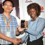 (L-R) Dong Chengzu Huawei Devices Uganda Head of Retail and Marketing Department and Jean Baguma Huawei Device Uganda Marketing Manager officially unveil the Huawei P9
