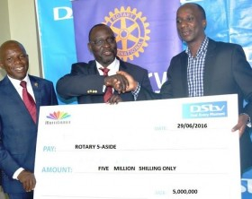 (R-L) MultiChoice Uganda General Manager , Charles Hamya hands over UGX 5 million to Governor Rotary Uganda, Robert Nsibirwa and Rotary Uganda Chairman , Francis Sentamu for the charity 5-Aside courtesy of DStv