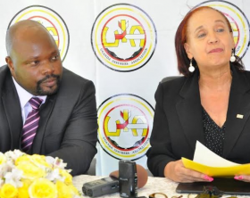 Guest Of Honor Dr. Maggie Kigozi addresses the media at the press conference to launch the new UIA Awareness Consumer campaign. On the left is the UIA publicity committee Chairman Mr. Newton Jazire.