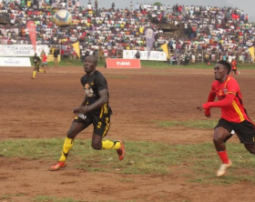 Uganda Cranes Striker Erisa Sekisambu races for the ball against Eastern Select side defender at Mbale Municipal Stadium