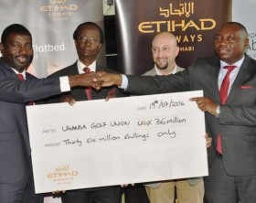 Toyin Alaran, Etihad Airways' General Manager, Uganda (L) presents the Uganda Golf Union President, Johnson Omolo (R) with a cheque worth Shs36 million for this year's Uganda Golf Open. Looking on are Uganda Golf Union Captain, Dr. Anthony G. Kerali (2nd L) and Vice Captain, Faiz Alar.