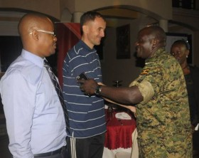 Gen. Katumba Wamala shakes hands with Micho