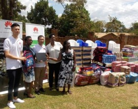 Huawei Officials Mr Patrick Tong(L) Huawei Public Relations director and Zhangzhiheng(middle), Huawei Public Relations Southern Africa Regional Director hand over items to Rahab Foundation trustees.