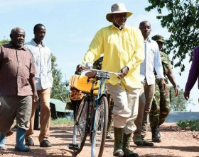 President Museveni fetches water on a bicycle