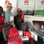 (L-R)Chris Tuhaise of Space Marketing, Zoey Dong Chengzu, Retail Manager Huawei Uganda and Jean Baguma, Marketing Manager Huawei Uganda display a section of goodies to be won by lucky customers