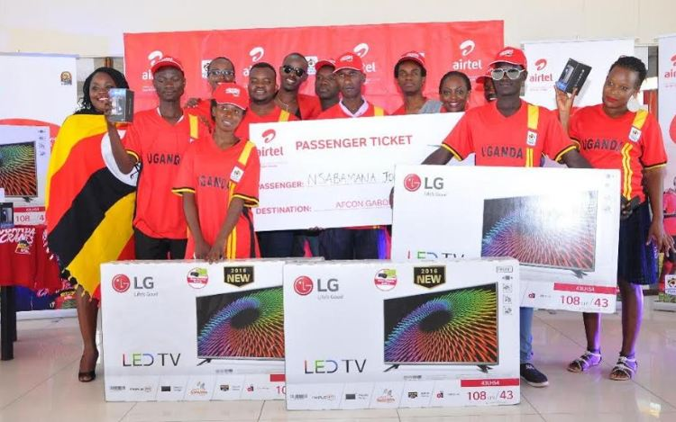 Airtel Uganda staff pose for a group photo with the lucky winners during the final draw of Tulumbe AFCON campaign at Airtel head offices.