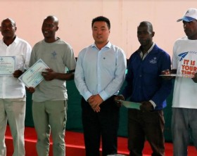 Mr. Li Jincheng (C), Project Manager, Kampala Entebbe Expressway, takes a group photo with some of the outstanding employees of CCCC, at the company's head office in Kitende