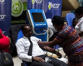 The Managing Director of the National Social Security Fund (NSSF), Richard Byarugaba donating blood at the launch of the fund's annual blood drive.