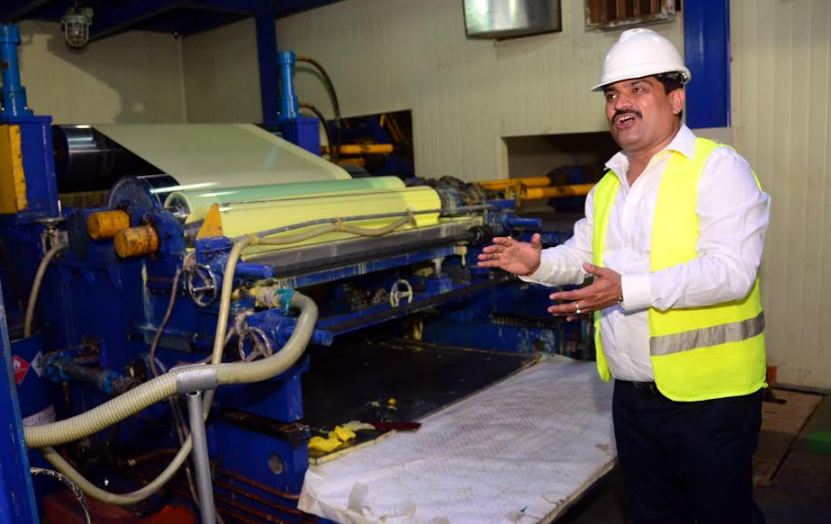 Plant Manager, Santosh Tiwari demonstrating the colouring machines to journalists. This was during a media visit to the Namanve plant.