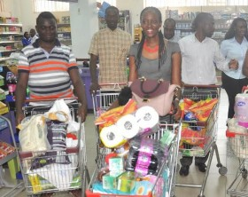 L-R: Jerome Birungi ,June Nyakahuma, Bashir Aliyu Yakasai, Martin Lutaaya and Racheal Phoebe Kabejja were among the 7 lucky winners of the final 60seconds trolley dash at the Quality Supermarket Naalya.