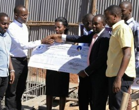Uganda Martyrs SSS Namugongo Old students handed over a 10 million dummy cheque to the school as part of the school gate rebuilding project