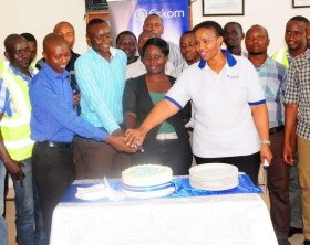 Eskom M.D (In white T-Shirt) and finance director (in blue shirt) Join the trainees in cutting the a farewell cake after completing a 3 months training in hydro power generation engineering.