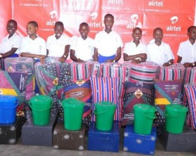 est performing pupils in 2016 PLE results at Airtel adopted school, St. Ponsiano Primary School in Makindye pose for a photo with their scholastic materials.
