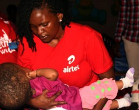 Airtel Uganda CSR Manager, Charity Rwabutomize Bukenya shares a moment with Aloysius Maria Ngombya who suffers from hydrocephalus.