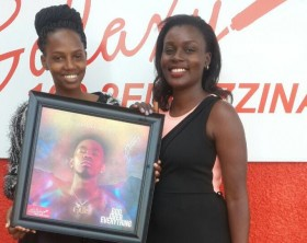 Patoranking gifts Galaxy FM with a GOE album copy