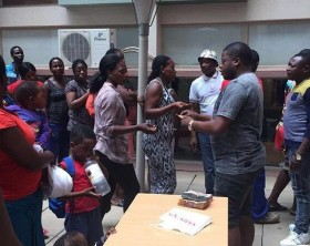 Ivan Ssemwanga gives out money to needy women in South Africa
