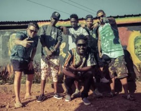 """Musicians who collaborated on the single, """"Sema"""", pose for a group photo"""