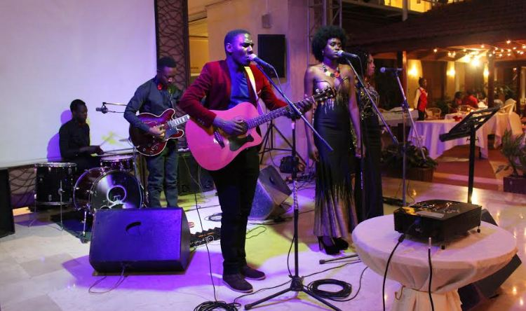 Kenneth Mugabi entertains guests at Paradise and Seven seas restaurant during the Valentine's day celebrations.