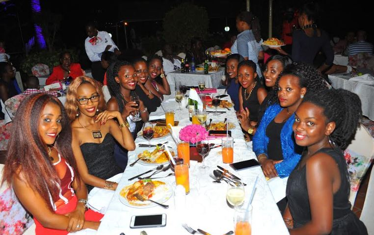 Ladies enjoy the meticulously prepared dinner as they celebrate women's day at Sheraton Kampala Hotel.