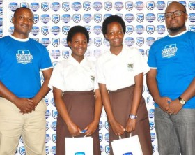Stanbic Bank Regional Manager, Ronnie Muganzi poses with the winners.