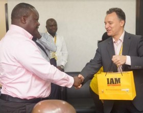 MTN Uganda CEO, Wim Vanhelleputte hands over a gift hamper to one of their high value customers.