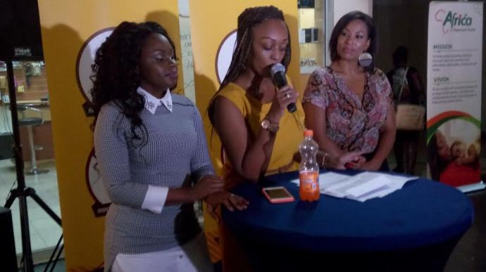 Product Marketing Manager Aretha Rugasore (centre), flanked by Rema Namakula and Crystal Newman, addresses Ugandan women at the launch.