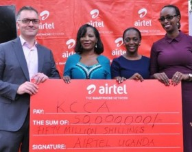 KCCA Executive Director Jennifer Musisi (2nd L) receives a dummy cheque of Ugx 50 Million from the Airtel Uganda officials.