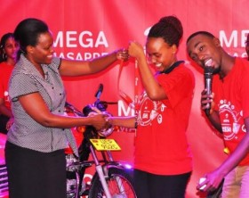 19 year old Kirabo Nina Mary from Fort Portal receives the keys to a brand new car she won in the Mega Masappe promo.