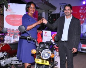 Airtel Uganda Marketing Director, Indrajeet Kumar Singh hands over motorbike keys to one of the lucky winners during the launch of Mega Masappe.