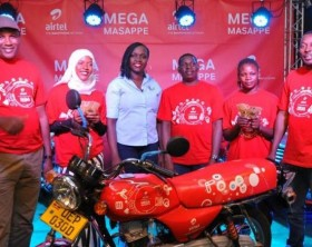 Airtel Uganda Customer Services Director, Lynda Nabayinda (3rd left) poses with winners in the Mega Masappe draw.