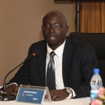 Mr. John Paul Okwi, the first President Board of Governors, Uganda Marketers Society, addresses media during a briefing held at Kampala Serena Hotel.