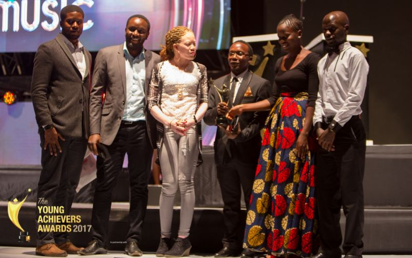 Milege Band members pose with their award during the 2017 Young Achievers Awards
