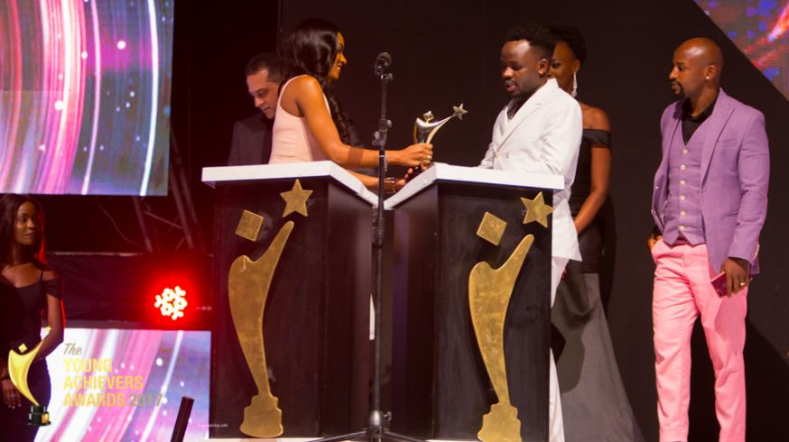 Abryanz receives his award at the 2017 Young Achievers Awards