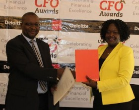 Nobert Kagoro, the Deloitte Country Managing Partner and Beatrice Isagayite, the Head of ACCA Uganda after signing an MoU during a press conference held at Kampala Serena Hotel