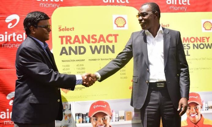 Vivo Energy's MD Gilbert Assi (R) and Airtel's MD Somasekhar V.G shake hands during the unveiling of their partnership.