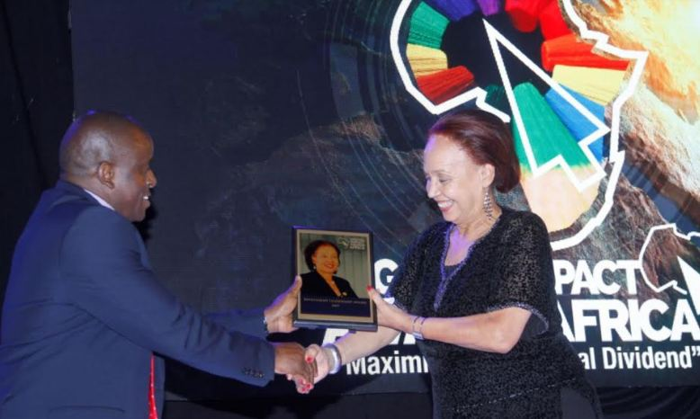 Prof Maggie Kigozi accepting her award at Digital Impact Awards Africa