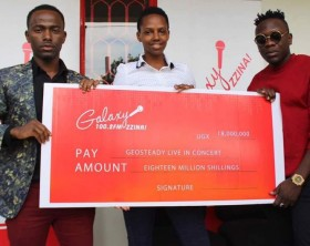 Galaxy FM's Jonathan Nalebo and Prim Asiimwe hand over a dummy cheque to Geosteady.