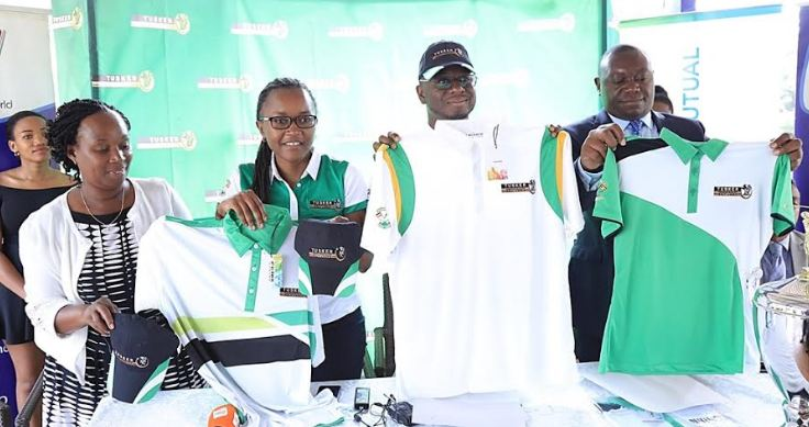 Uganda Breweries Limited Head of Beers, Estella Muzito(2nd left) with members of the Golf Union during the the tournament kits handover.