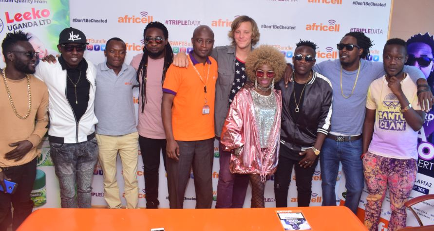 Ronald Maro poses with of the artistes who jetted in for his Nzira Nago concert.