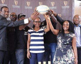 UBL Head of Beers Estella Muzito (C) poses for a photo members of the Uganda Rugby Union